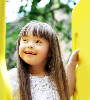 little girl on yellow slide